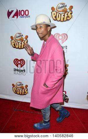 NEW YORK-DEC 12: Singer Pharrell Williams attends Z100's Jingle Ball 2014 at Madison Square Garden on December 12, 2014 in New York City.