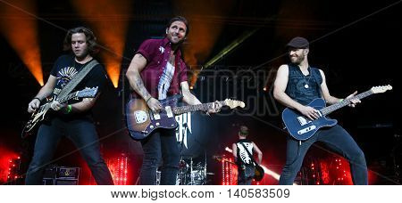 FARMINGVILLE, NY-JULY 3: Canaan Smith (C) performs at the 6th Annual Fest at the Pennysaver Amphitheater on July 3, 2016 in Farmingville, New York.