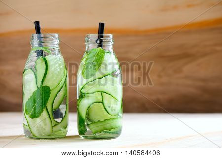 Cucumber and mint infused water in two bottles