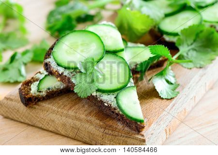 Cucumber and whipped feta cheese sandwiches with rye bread