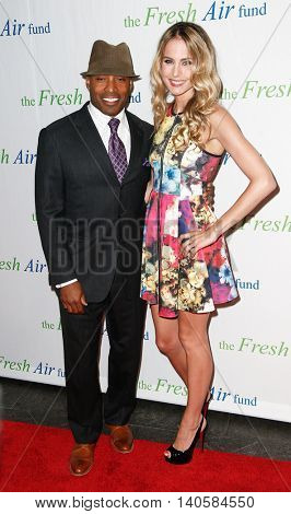 NEW YORK-MAY 29: Former NFL player Tiki Barber and wife Traci Lynn Johnson attend the Fresh Air Fund Spring Gala Salute at Pier Sixty at Chelsea Piers on May 29, 2014 in New York City.