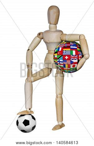 Wooden dummy with a soccer ball and the sphere of national flags on white background