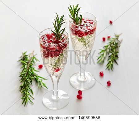 Fizz with pomegranate seeds and rosemary, festive winter drink