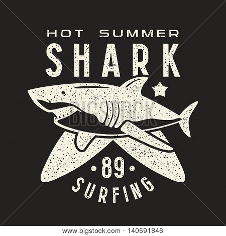 Graphic design for t-shirt with the image of shark. White print on black background