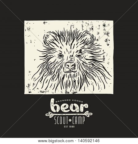 Stock vector linocut with a picture of bear and typographic composition. White print on black background