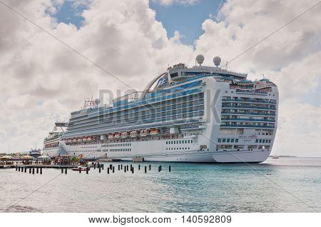 Kralendijk Bonaire - December 2 2011: International Cruise Ship Emerald Princess anchored at Kralendijk the capital and largest city of the island Bonaire Netherlands Antilles.