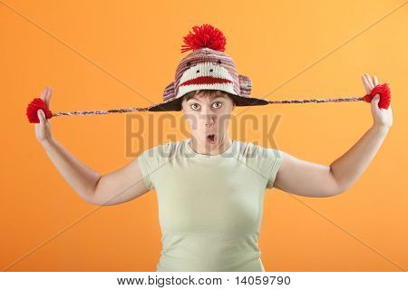 Woman Plays With Hat