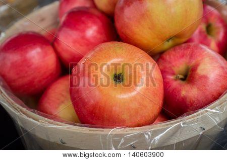 Basket of organic red braeburn apples at local farmers market