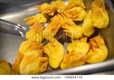 Chinese cheese wonton buffet tray appetizer at restaurant