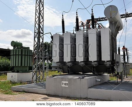 big transformers and reactors on substation day