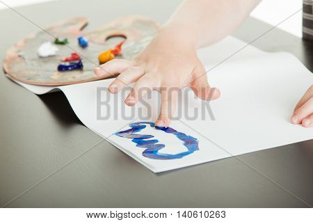 Young Child Having Fun Finger Painting