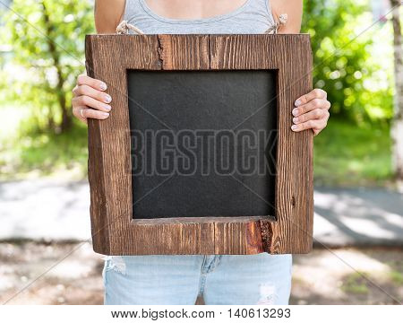 Woman Holding Empty Chalkboard With Wooden Frame. Template Mock Up
