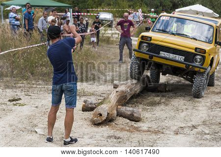 Lviv Ukraine - August 23 2015: Navigator shows the way when the driver of vehicle overcomes the track on of sandy career near the city Lviv Ukraine.