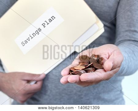 Man holding loose coins & folder with savings documents