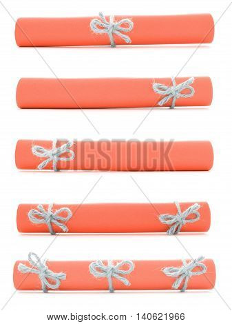Orange paper scrolls tied with handmade ropes and bows isolated