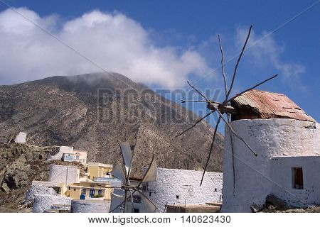 Photo of windwill in Olympos village in the island Karpathos, Greece