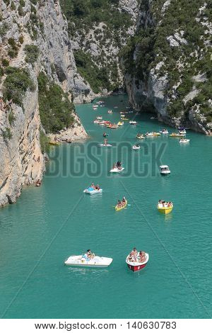 Sainte Croix, France - July 9, 2016: People sailing in the Gorges du Verdon, also called the Grand Canyon of Verdon, Provence, France