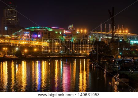 CLEVELAND OH - MAY 28 2016: View of Quicken Loans Arena (the Q) glowing above the Cuyahoga River. The Q was the site of the NBA Finals and of the Republican National Convention in July.