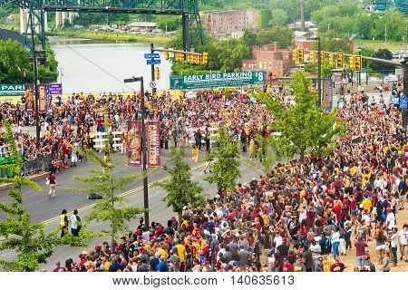CLEVELAND OH - JUNE 22 2016: Crowds line the streets next to the Q in anticipation of the victory parade celebrating the Cleveland Cavaliers' first NBA championship three nights earlier