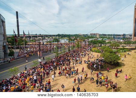 CLEVELAND OH - JUNE 22 2016: Crowds line the streets next to the Q in anticipation of the victory parade celebrating the Cleveland Cavaliers' winning their first NBA title three nights earlier.