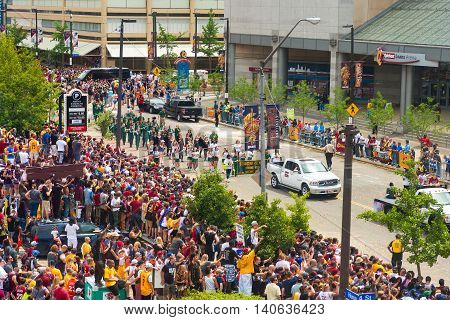 CLEVELAND OH - JUNE 22 2016: The band from LeBron James' alma mater St Vincent-St Mary in Akron marches past cheering crowds in the Cavs' NBA championship parade.