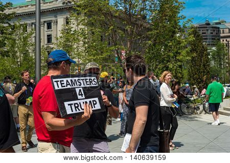 CLEVELAND OH - JULY 20 2016: A Trump supporter holds a sign among the crowds of people on Public Square during the Republican National Convention