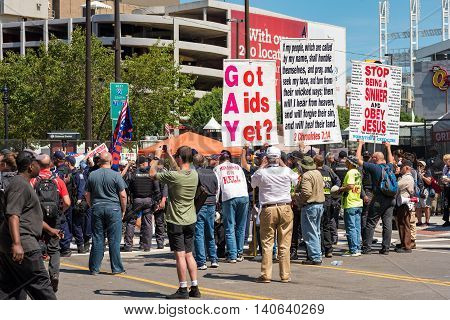 CLEVELAND OH - JULY 20 2016: A hard-core extremist religious group draws a crowd of the curious onlookers on Prospect Avenue during the Republican National Convention.