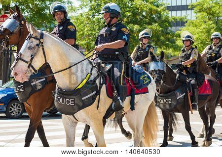 CLEVELAND OH - JULY 20 2016: Cleveland Mounted Police ride onto Public Square as part of the vast peacekeeping force during the Republican National Convention.