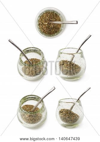 Glass mate calabash vessel with a dry mate tea leaves and bombilla drinking straw inside it, composition isolated over the white background, set of five different foreshortenings