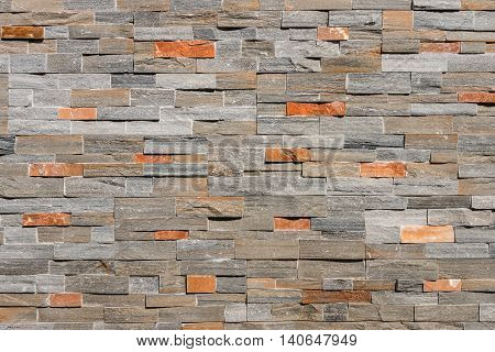 closeup of natural stone wall cladding background
