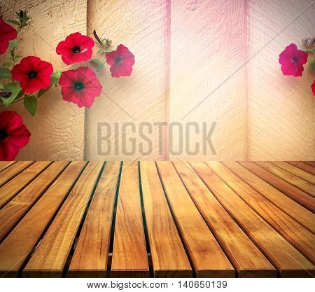 old wood table top on wall with red creeper flowers on wall background