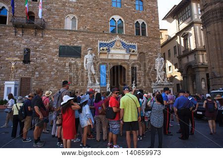 FLORENCE ITALY - JULY 12: Tourists in the Signoria square on July 12 2016