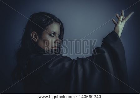 Magician, nude brunette woman with black cloth