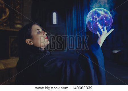 Gothic magician, Young beautiful girl with energy sphere, sorcerer