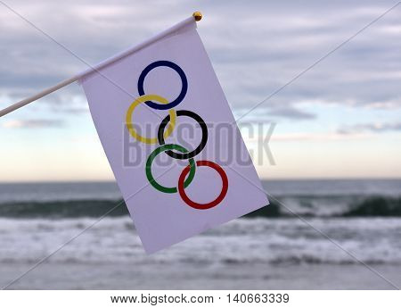 Sydney, Australia - Jul 31, 2016. Olympic flag on the beach. Summer Olympic Games.