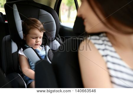 Mother and child in car. Safety driving concept