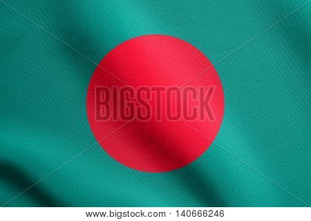 Flag of Bangladesh waving in the wind with detailed fabric texture. Bangladeshi national flag.