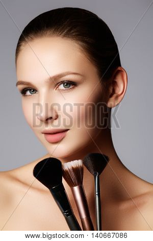 Closeup Portrait Of A Woman Applying Dry Cosmetic Tonal Foundati