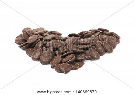 Heart shape made of cooking chocolate teardrop shaped chips, composition isolated over the white background