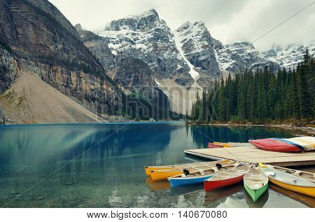 Moraine Lake and boat with snow capped mountain of Banff National Park in Canada