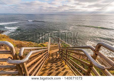 Ladera Street ladder overlooking ocean at Sunset Cliffs in San Diego, California.