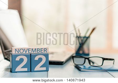 November 22nd. Day 22 of month, calendar on financial adviser workplace background. Autumn concept. Empty space for text.
