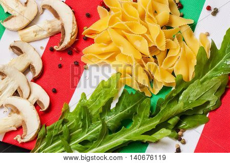 Italy flag, italian food . Cuisine is characterized by simplicity, with dishes having only four to eight ingredients. Italian cooks rely on quality of ingredients rather than elaborate preparation.