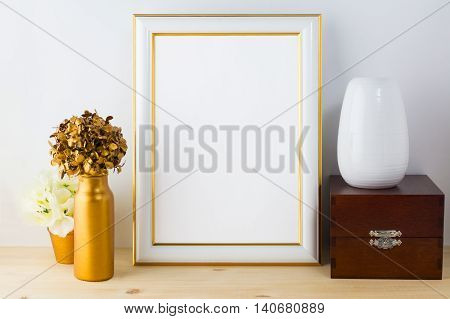 Frame mockup with vases wooden box and golden flower pot. Poster white frame mockup. Empty white frame mockup for presentation artwork.