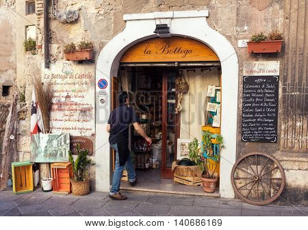 CAGLIARI ITALY - JULY 07 2016: Entrance of traditional grocery shop in old town of Cagliari Italy