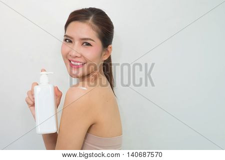 Body Lotion, Portrait Of Beautiful Young Woman Looking At Camera. Beautiful Asian Female Model On Wh