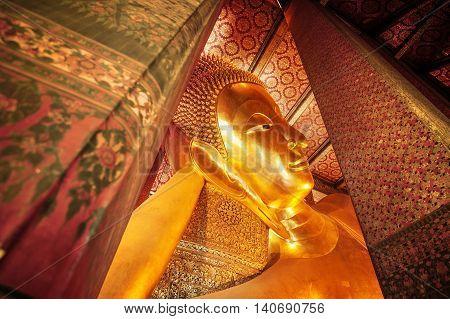 Close up Reclining Buddha gold statue Wat Pho Bangkok Thailand