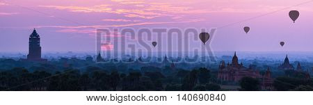 Panorama Hot air ballons over pagodas in sunrise at Bagan Myanmar.