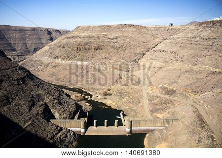 Panoramic view of Katse Dam wall in Lesotho Southern Africa. Lesotho Highlands Water Project of the Kingdom of Lesotho and the Republic of South Africa. Artistic retouching.