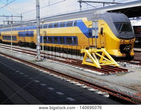 dutch yellow and blue train in railway station in maastricht netherlands